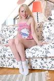 Petite teen blondie leaves only her white socks on