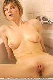 Shorthaired seductress takes a milk bath