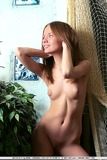 Redhead with puffy nipples posing nude
