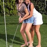 Two young babes enjoy lesbian sex on a golf course
