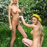 Two amazingly natural blonde girls naked alfresco