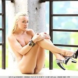 Athletic blonde in nothing but her heels out under the sun