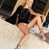 Colourful heels on a blonde teen exposed outdoors