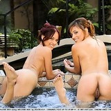 Sexy lesbian twins are outdoors naked in the pool together