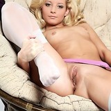 Tiny tit blonde in stockings shows shaved twat