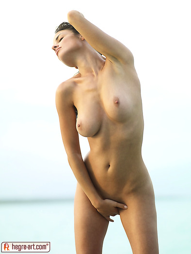 Young nude model from Latin America hits the beach