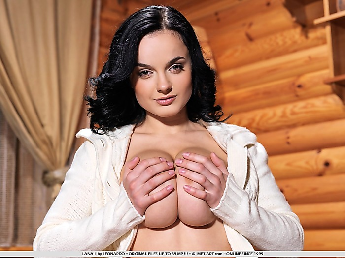 Gorgeous babe with huge tits and a shaved smooth pussy