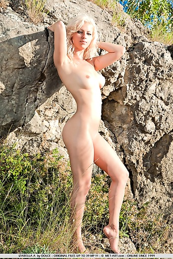 Blonde babe outdoors at beach flashes big tits